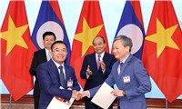 EVN ký nhiều biên bản ghi nhớ phát triển dựán và mua điện từ Lào