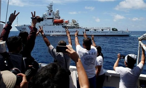 China under pressure at Asia summit over sea row