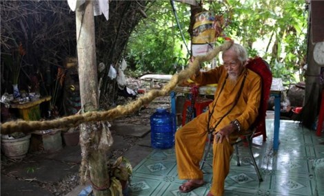 Vietnamese man with five-metre hair says lifelong grow-out is divine calling